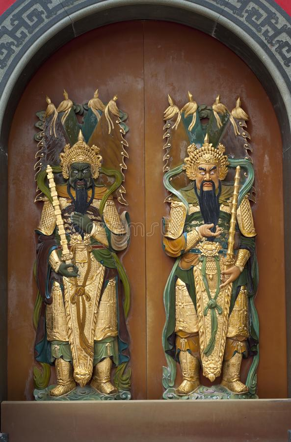 Guardians of the door at a Chinese Temple royalty free stock images