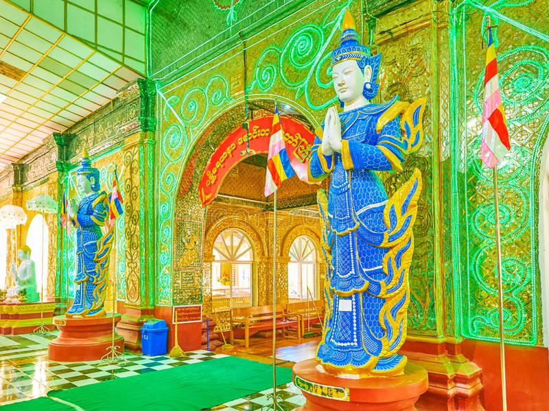 The guardians of Kyauktawgyi Buddha Temple in Mandalay, Myanmar. MANDALAY, MYANMAR - FEBRUARY 23, 2018: The two sculptures of Spirits Nats guard the entrance to stock photo