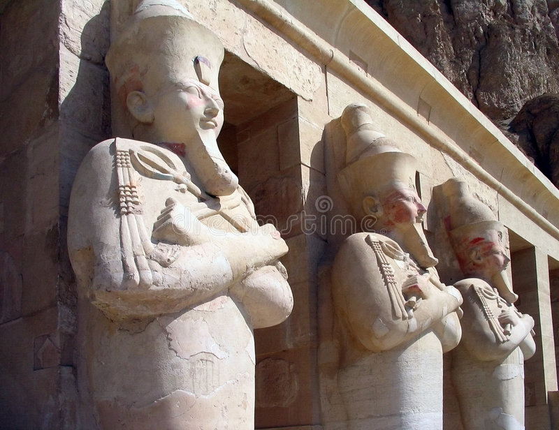 Guardians at the Temple of Queen Hatshepsut, Egypt. Stone statues guard the entrance to the Temple of Queen Hatshepsut, at El Deir El Bahari, Egypt stock photography