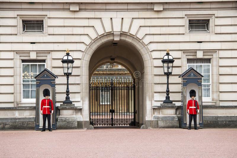 Guards at Buckingham Palace in London England. A picture of the guards at Buckingham Palace in London England stock image