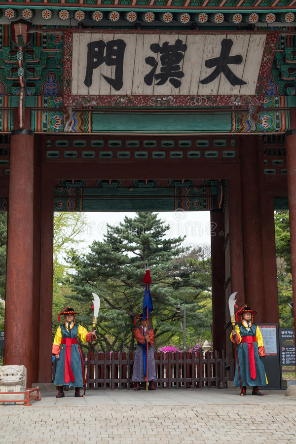 Guards at the Deoksugung Palace in Seoul. Three guards at the main gate to the Deoksugung Palace in Seoul, South Korea royalty free stock photos