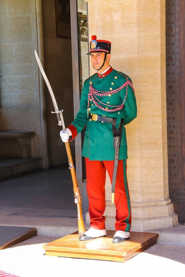 Guardsman in colorful uniforms on a post near the Palazzo Pubblicco in San Marino. SAN MARINO. SAN MARINO REPUBLIC - AUGUST 08, 2014: Guardsman in colorful stock photo