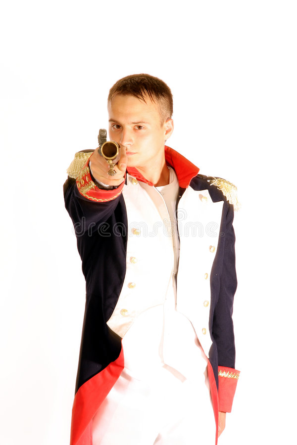 Guardsman in full-dress uniform aiming gun royalty free stock photo