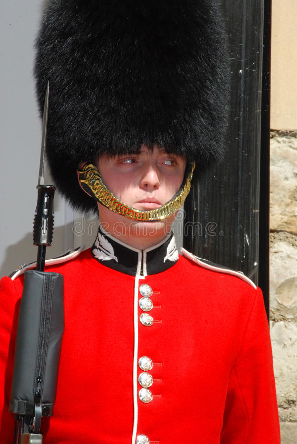 Guardsman on guard 3. Guardsman from F Company Scots Guards on guard at the Tower of London. Useful for any story relating to UK military defence cuts; this duty stock photography