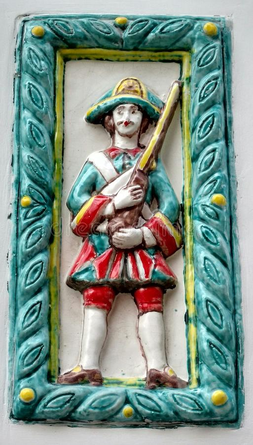 Guardsman of the Preobrazhensky regiment. On the ceramic tile there is a guard of the Preobrazhensky regiment with a musket stock photography