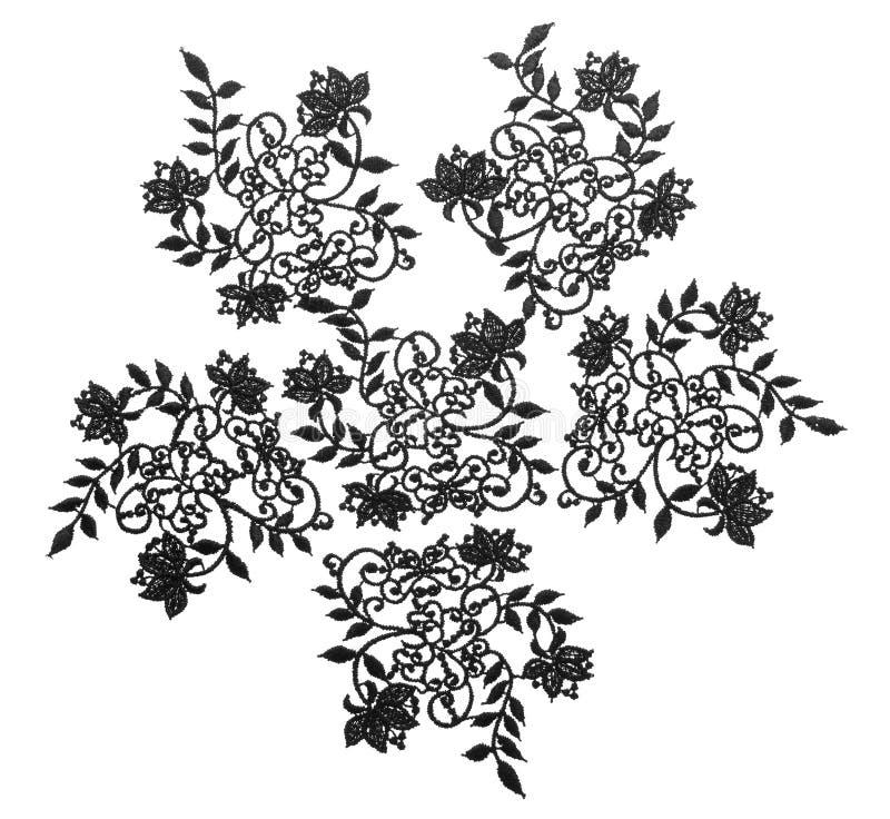 A guarnição bordada floral da tela do laço, pano floresce o branco isolado fotos de stock
