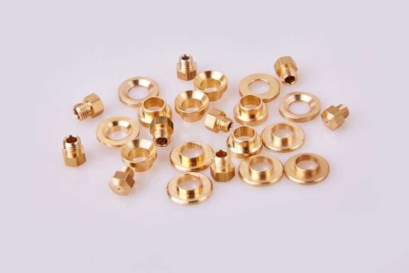 Guarnizioni piane d'ottone bronzee e GIGLEURs dell'hardware delle rondelle fotografia stock