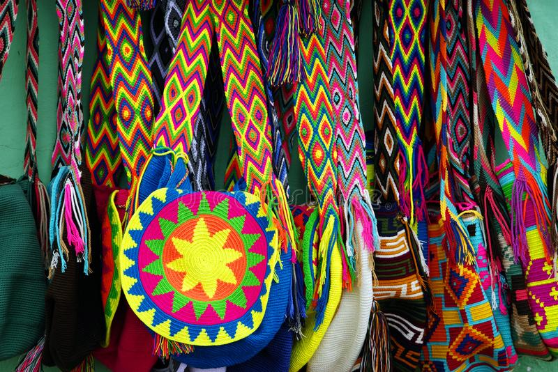 GUATAPE, ANTIOQUIA, COLOMBIA, AUGUST 08, 2018: Bright and colorful hand-made souvenirs from Guatape village. Wayuu mochilas bags are one of Colombia`s most stock image