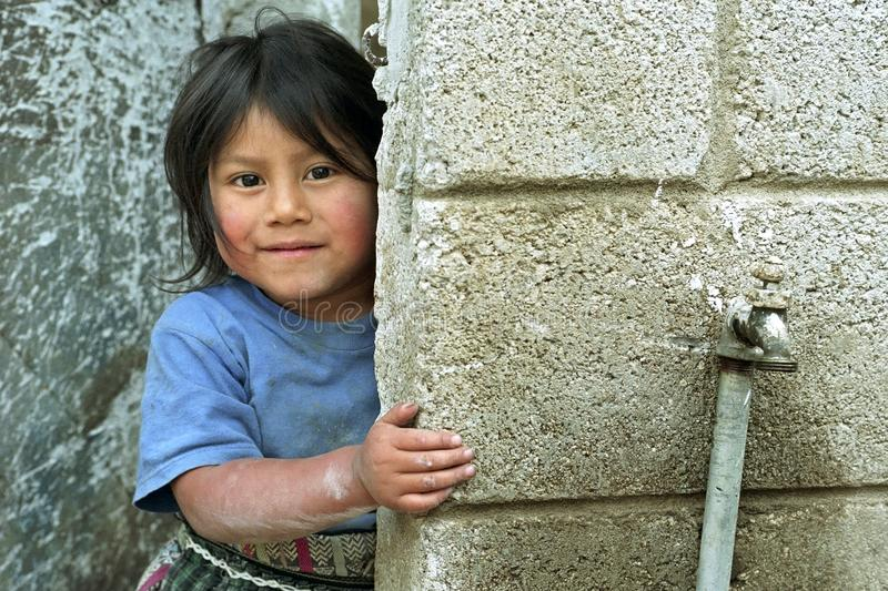 Portrait of Guatemalan Indian girl with happy face. Guatemala, Quetzaltenango Department, Cantel mountain village: Portrait of little Indian girl. This Maya stock image