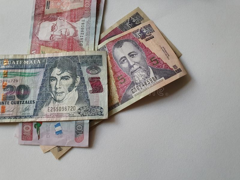 Guatemalan banknotes of different denominations on the table. Commerce, exchange, trade, trading, value, buy, sell, profit, price, rate, cash, currency, paper stock images