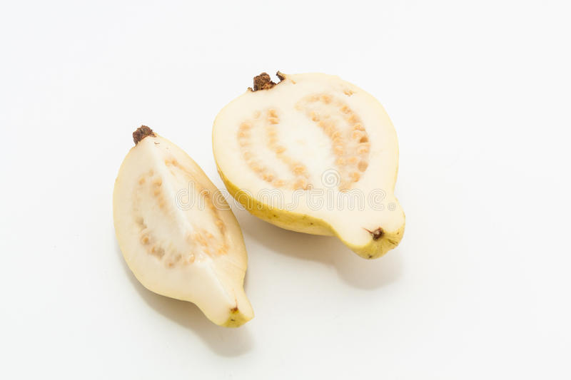 Guava fruit cut into two pieces. Riped guava fruit cut into two pieces royalty free stock images