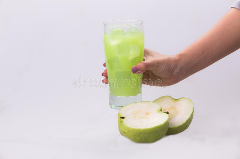 Guava icy fresh white backdrop. Guava is a high nutritional value. In a refreshing glass of chilled white background stock photos
