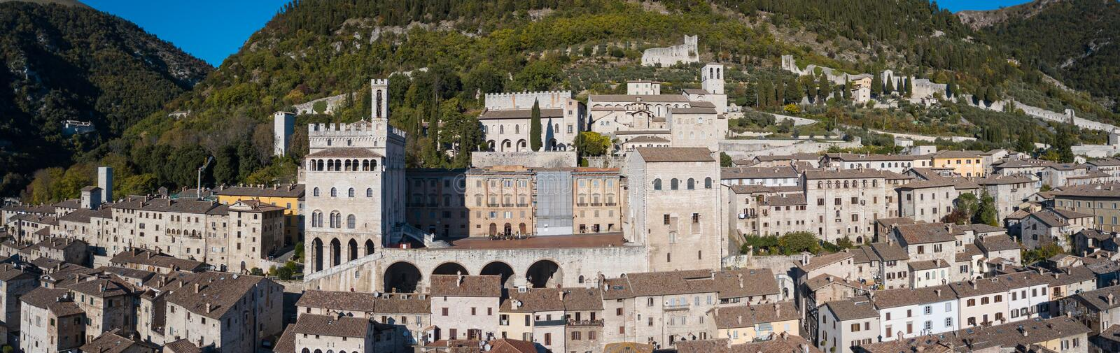 Gubbio, Italy. Drone aerial view of the city center, main square and the historical building called Palazzo dei Consoli. Gubbio, Italy. One of the most beautiful royalty free stock photo