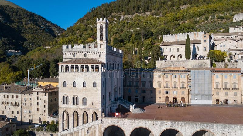 Gubbio, Italy. Drone aerial view of the city center, main square and the historical building called Palazzo dei Consoli stock photography