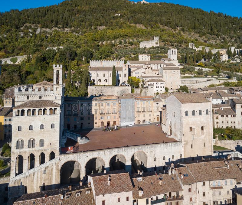 Gubbio, Italy. Drone aerial view of the city center, main square and the historical building called Palazzo dei Consoli stock photo