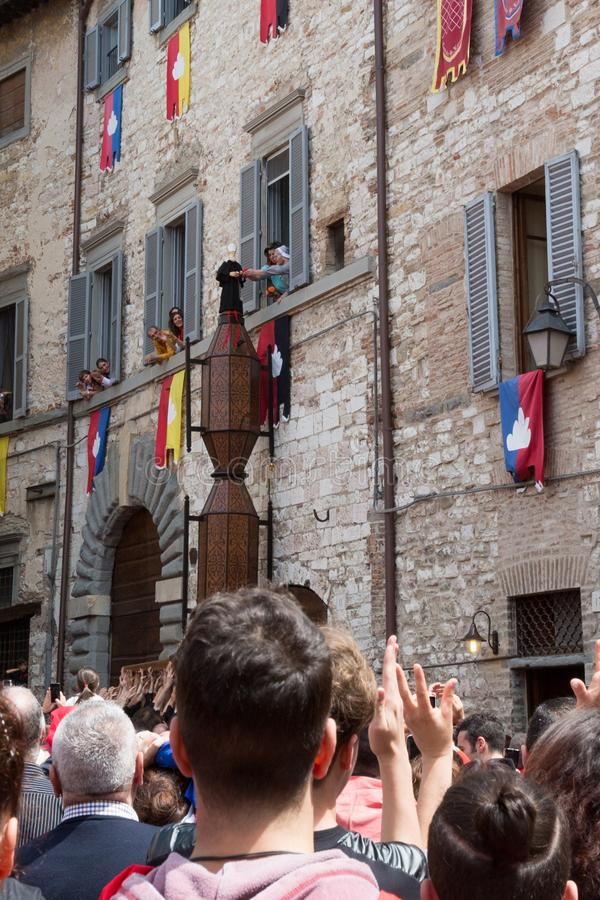 GUBBIO, ITALY - MAY 15 2016 - The Sant` Antonio Ceri is blessed by a nun is it is pararded around the city of Gubbio at the annua royalty free stock photo
