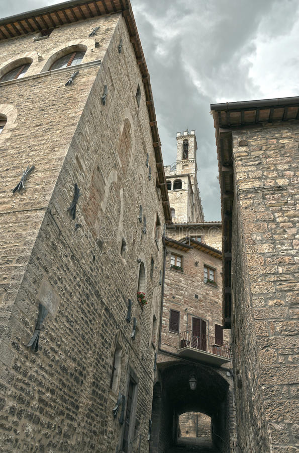 Gubbio street 1. Gubbio, typical street foreshortening with Consoli palace. The historical centre of Gubbio has a medieval aspect: the town is austere in royalty free stock photography