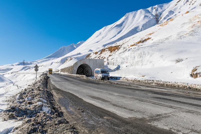 GUDAURI, GEORGIA - DEC.13, 2017 : The main high way from Gudauri to Kazbek mountain, Georgia stock photography