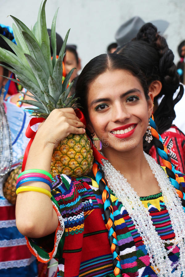 Guelaguetza festival, Oaxaca, 2014. Traditional Mexican dancer with a pineapple at the Guelaguetza festival, Oaxaca on July, 2014 stock photography