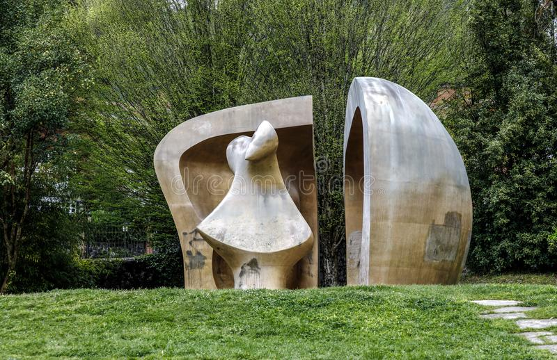 Sculpture by Henry Moore. Guernica, Spain - April 09, 2018: Sculpture by Henry Moore `Large Figure in a shelter`. Brought to Gernika in 1991. This sculpture is stock images