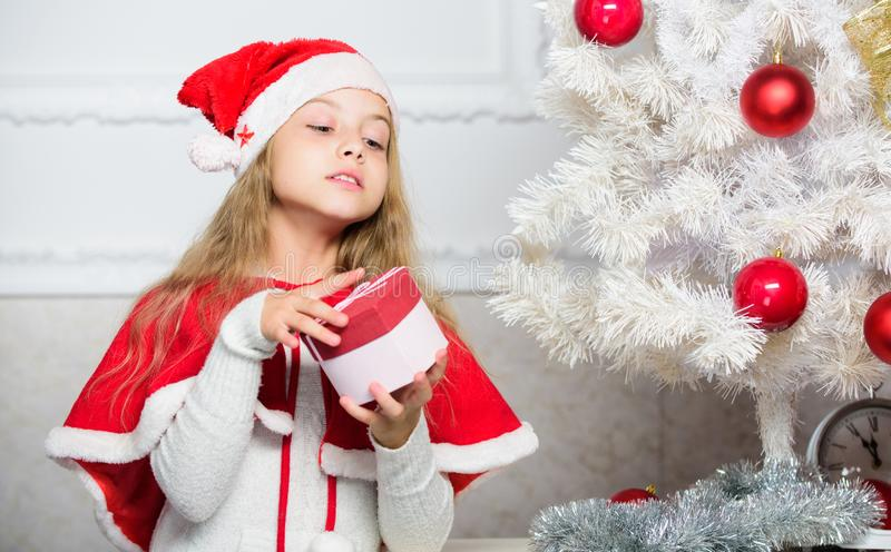 Guess what inside box. Winter holiday tradition. Kid with christmas present. Reason children love christmas. Girl royalty free stock images