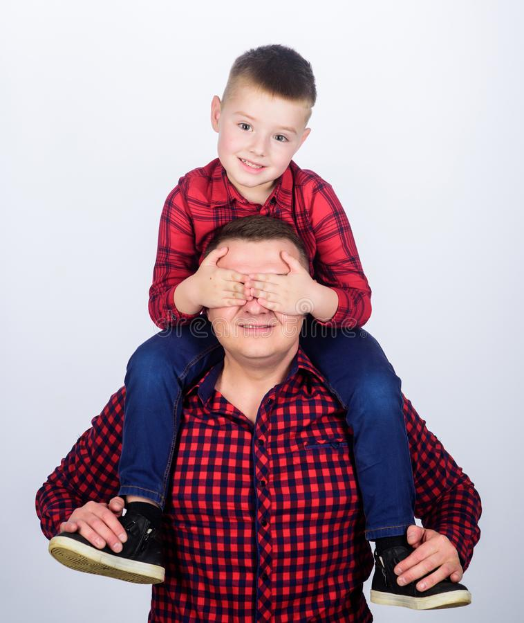 Guess who. childhood. parenting. little boy with dad man. happy family. fathers day. father and son in red checkered. Shirt. Young perfectionist. keep secret stock image