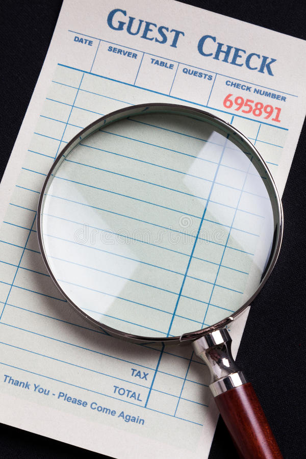 Download Guest Check And Magnifying Glass Stock Photo - Image: 37655238