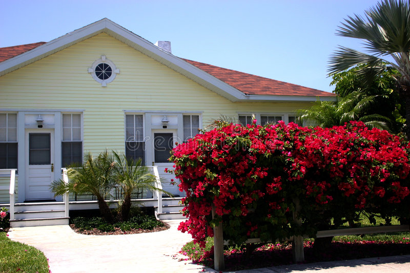 Guest Cottage with Red Bougainvillea royalty free stock photo