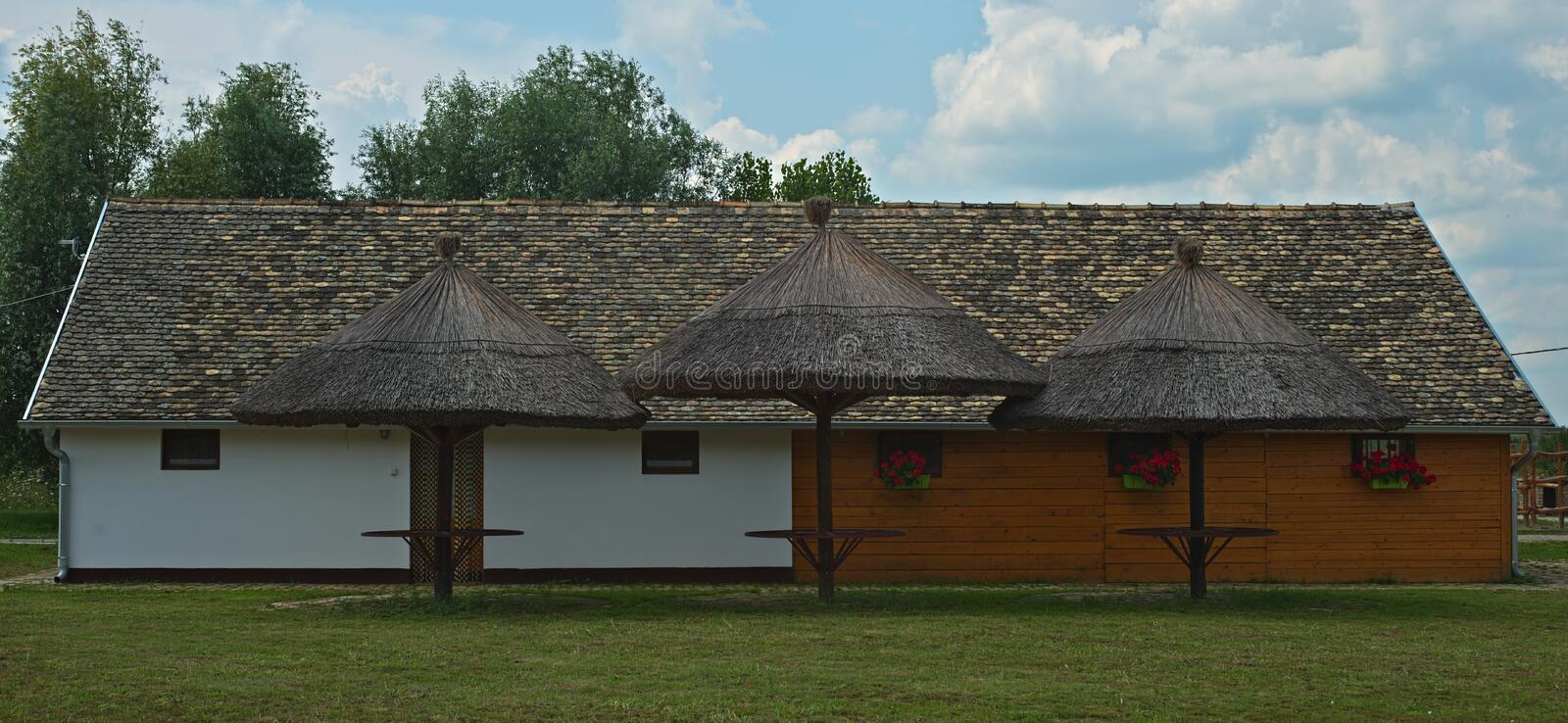 Guest house with three cane shed at serbian farm. Rural guest house with three cane shed at serbian farm royalty free stock image