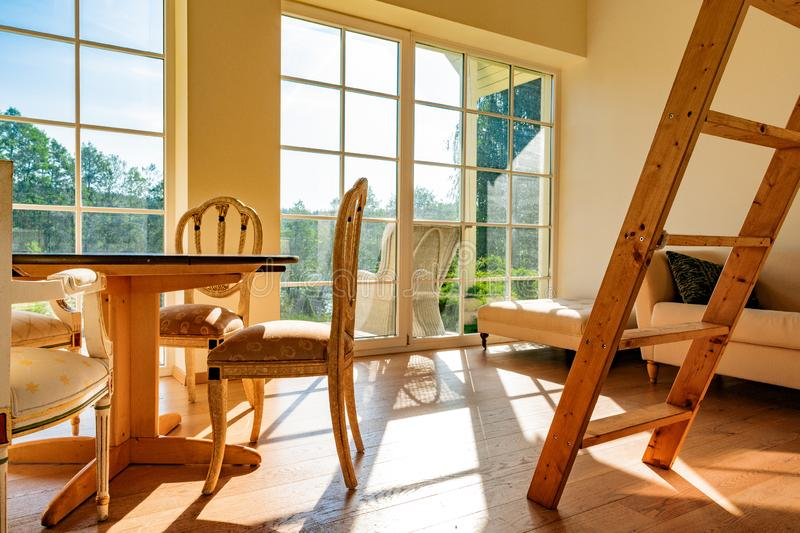 Guest house wooden interior on a sunny day with clear blue skies. stock images