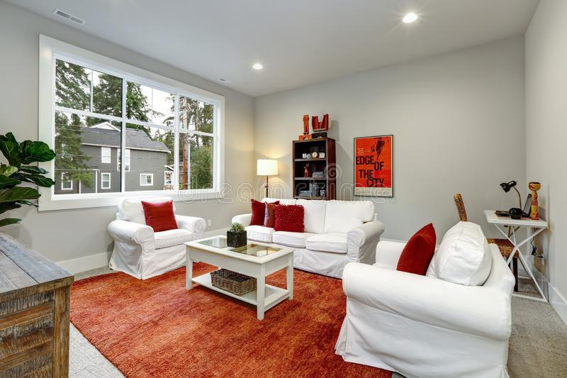 Guest modern Living room interior with red pillows and rug stock photo