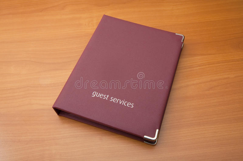 Guest Services Folder. A generic hotel guest services folder on a desktop royalty free stock photo