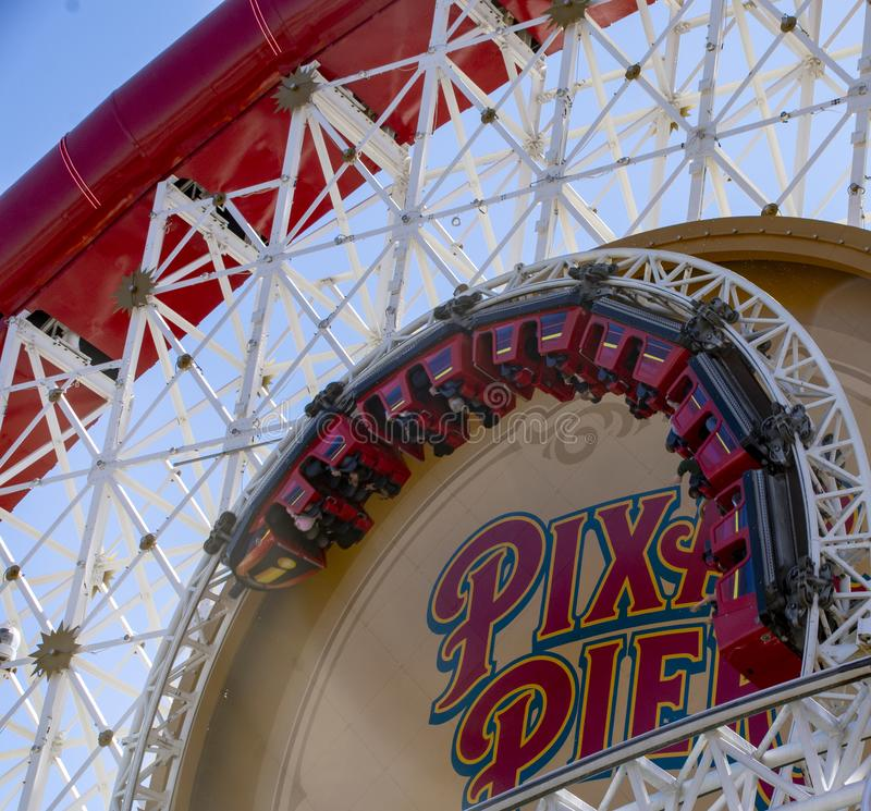 Upside down on the Pixil Pier Rollercoaster Ride. Guest visiting Disney`s California Adventure during the California Resident season brave the Incredicoaster as stock photography