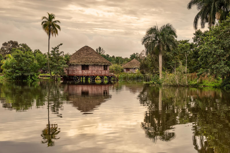 Guest water bungalows, Guam Indian Village, Cuba. Guam, Cuba, on the river, under the palm trees royalty free stock image