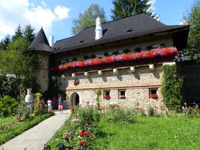 Guesthouse very in bloom of a monastery of the Bucovina in Romania. August 2014. stock images