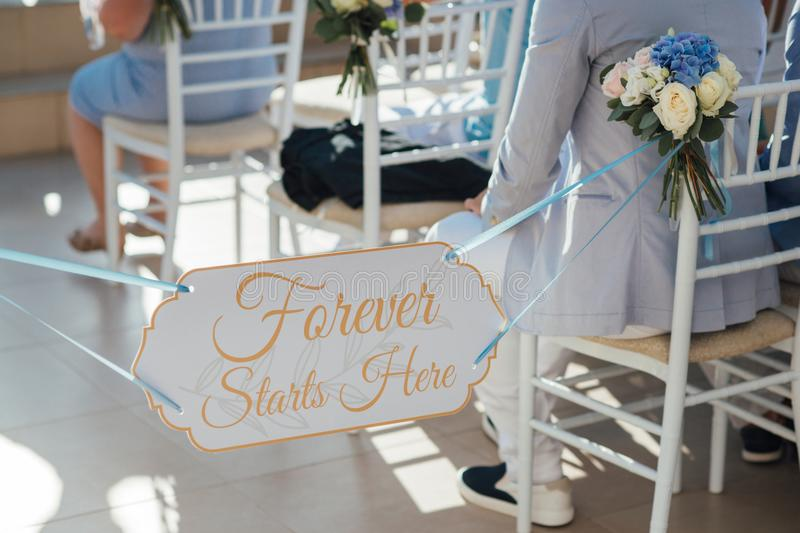 Guests are waiting for the bride and groom at the wedding ceremony on the island of Santorini stock photos