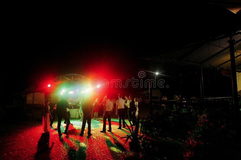Guests dancing at wedding party reception, music fun and lights stock photo