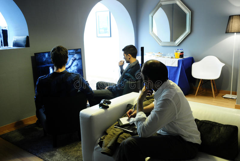 Young Men Playing Video Games @The Playce stock image