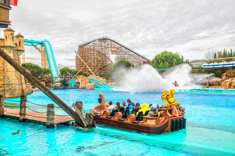 Guests riding boats in Europa-Park. Europa-Park is a second largest park resort in Europe. royalty free stock photo