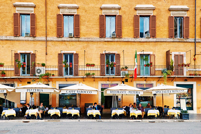 Guests sit on the beautifull restaurant terrace in Piazza Navona in Rome, Italy. ROME, ITALY - OCTOBER 29: Guests sit on the beautifull restaurant terrace in stock images