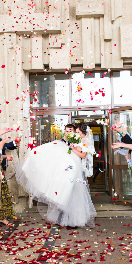 Guests Throwing Confetti Over Bride And Groom At Wedding stock image