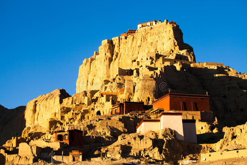Guge palace ruins in Tibet. Guge palace ruins in sunrise light stock photo