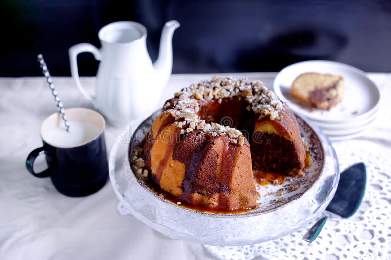 Gugelhupf bundt marble cake with caramel and nuts stock photo