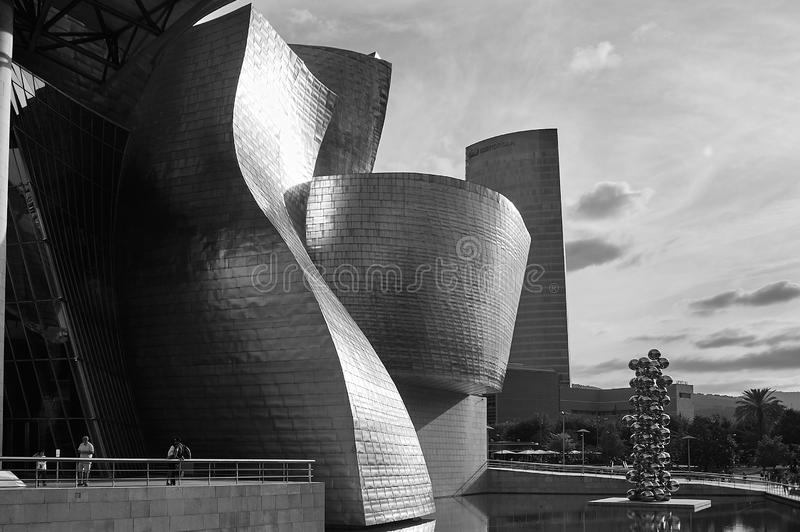 Guggenheim Museum in black and white, Spain. Black and white view of the exterior of the Guggenheim museum in Spain with reflections of the sun outside royalty free stock photography