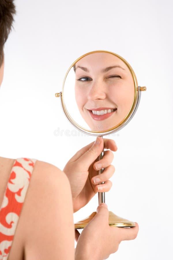 Guiño en espejo imagenes de archivo