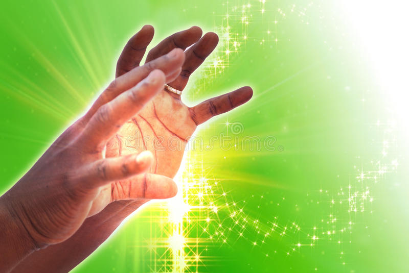 GUIDANCE ENERGY. A male hand guiding spiritual energy received after long time of meditation stock image