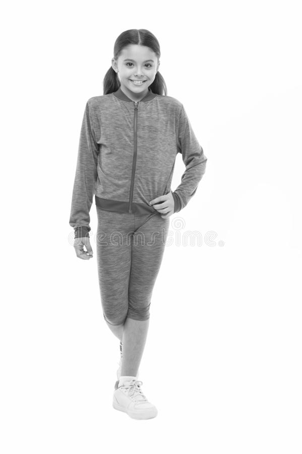 Guidance on working out with long hair. Deal with long hair while exercising. Girl cute kid with long ponytails wear. Sportive costume isolated on white stock photo