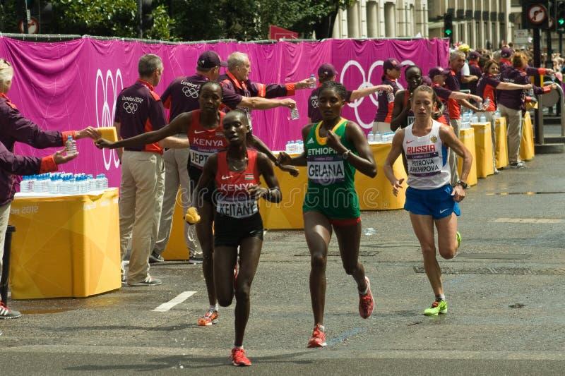 Guide di maratona delle donne olimpiche fotografia stock libera da diritti