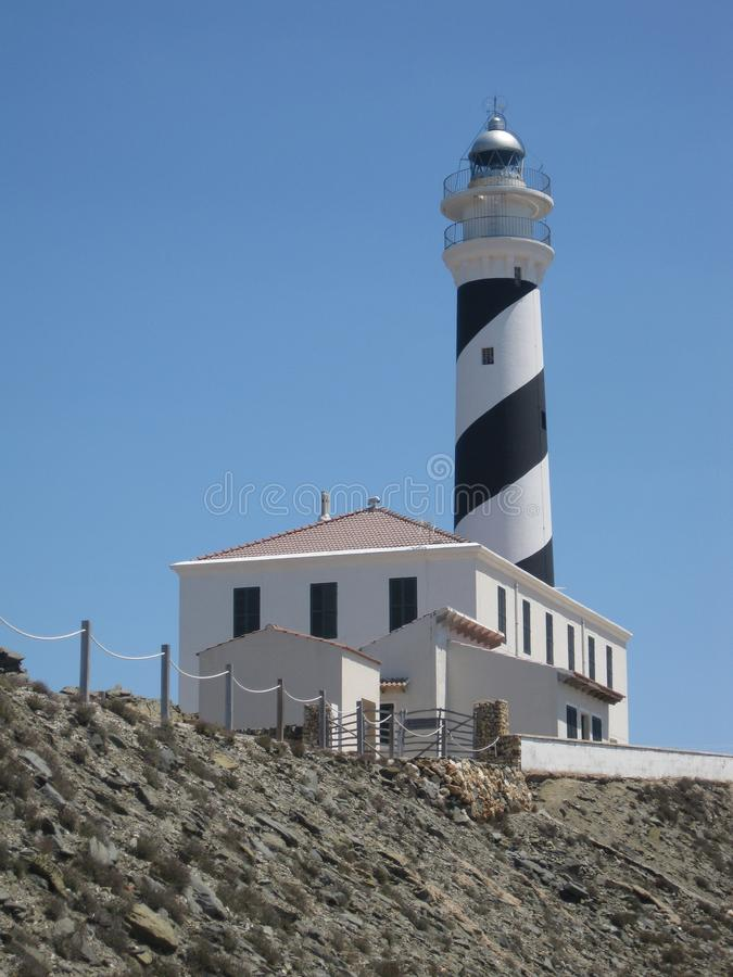 Guide lighthouse on top of a hill stock images
