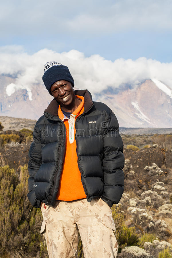 Guide standing before Mount Kilimanjaro stock photos